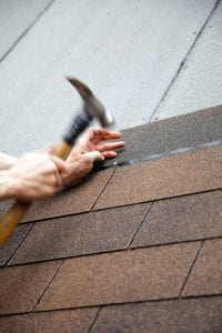 Should You Have Roofing Contractors Install a Metal Roof